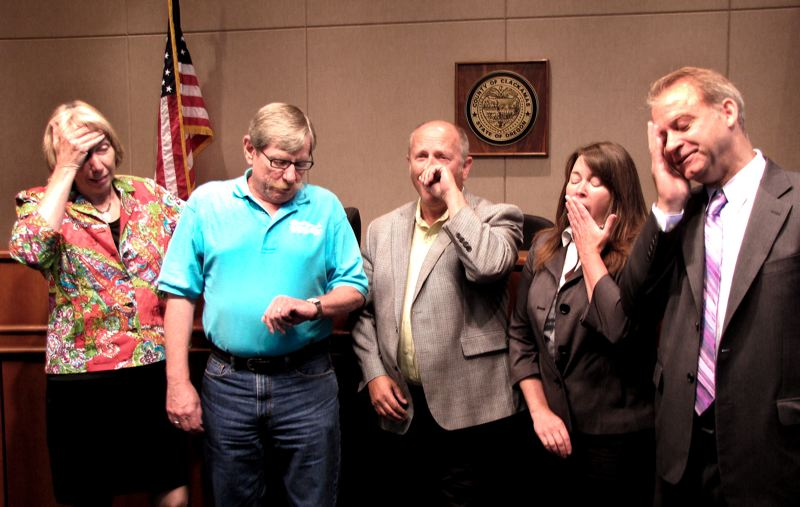 by: CONTRIBUTED PHOTO BY CLACKAMAS COUNTY - After proclaiming Aug. 9 as Boring and Dull Day in perpetuity, the county commissioners were joined by the chairman of the Boring Community Planning Organization to sign the proclamation, but found it a dull activity and needed time to yawn, snooze or generally act bored. Pictured are, from left, Commission Chairwoman Charlotte Lehan, CPO Chairman Steve Bates (checking his watch), and commissioners Jim Bernard, Jamie Damon and Commission Vice Chairman Paul Savas.