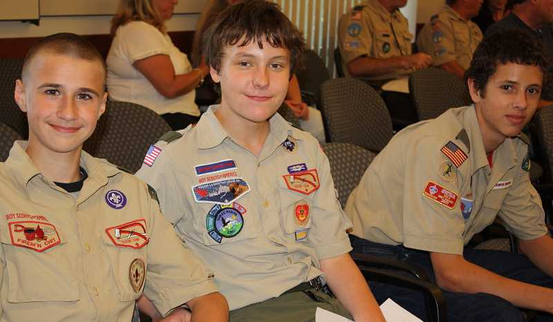 by: MARC BRANDEBERRY - Boy Scouts PJ Carr, Ben Brandeberry and Julian Gilmour from Troop 149 pose for a photo Monday at the West Linn City Council Meeting.