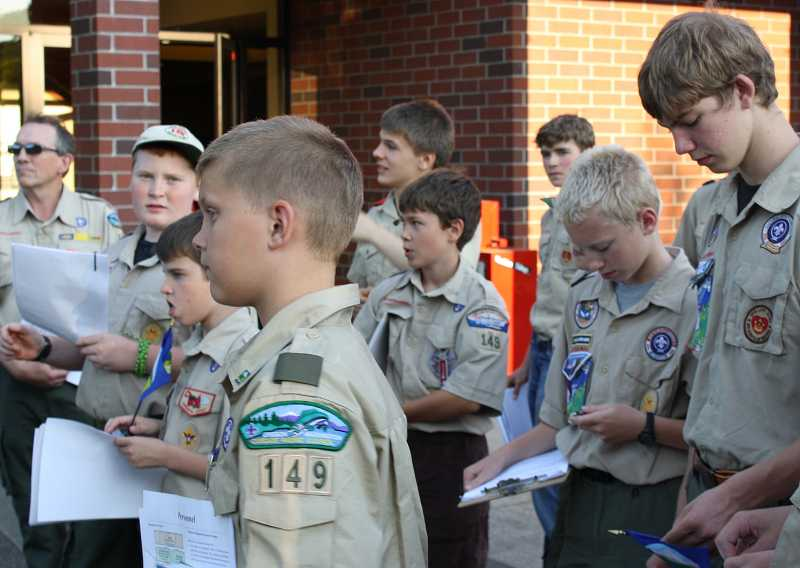 by: MARC BRANDEBERRY - Boy Scouts from Troop 149 learn about city government outside West Linn City Hall.