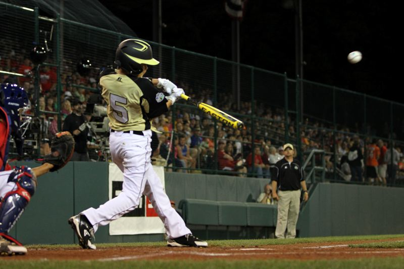 by: THE OUTLOOK: DAVID BALL - Christian Turner belts a hit during Greshams elimination game against New Jersey on Saturday night.