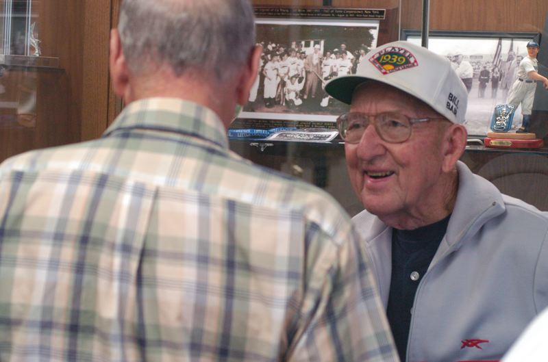 by: THE OUTLOOK: DAVID BALL - The leagues first batting champion, Bill Bair, talks with a visitor at the one-room Original League museum on West 4th Street in Williamsport.