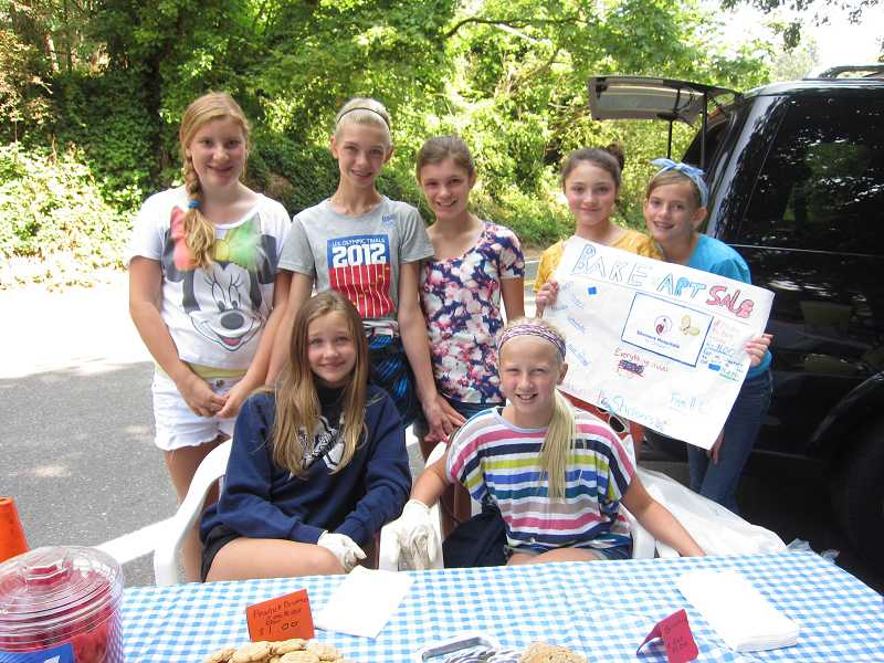 by: SUBMITTED PHOTO  - From left, Eliesse Jakotich and her friends, Mandy Mitchell, Morgan Keudell, Megan Potter, Rosie Booth, Katherine Ragen and Jane Ferguson, recently held a fundraising event for Shriners Children's Hospital.