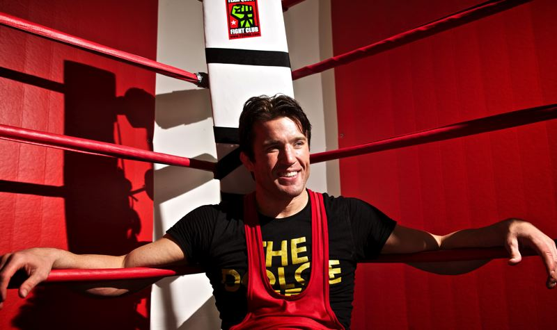 by: JAIME VALDEZ - FAB FIGHTER -- UFC middleweight Chael Sonnen, a Tualatin native, smiles as he sits in the ring at Team Quest during an interview with The Times earlier this summer.
