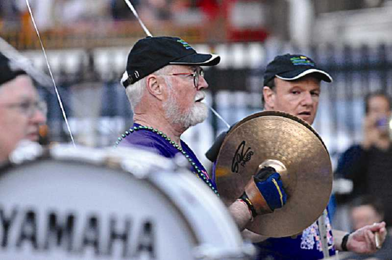 by: SUBMITTED PHOTO - At left, Robert Fulghum plays cymbals with the group in the Seattle Seafair Torchlight Parade on July 28.
