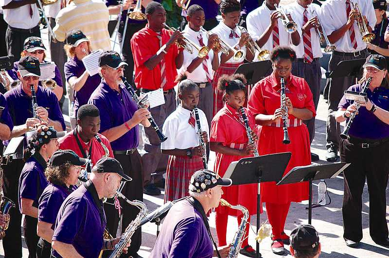 by: SUBMITTED PHOTOS - The Beat Goes On Marching Band has been treating regional audiences to lively shows since it first took the field in October for a halftime show. During a February trip to the Bahamas, top left, the lively band played alongside students at C.R. Walker High School.