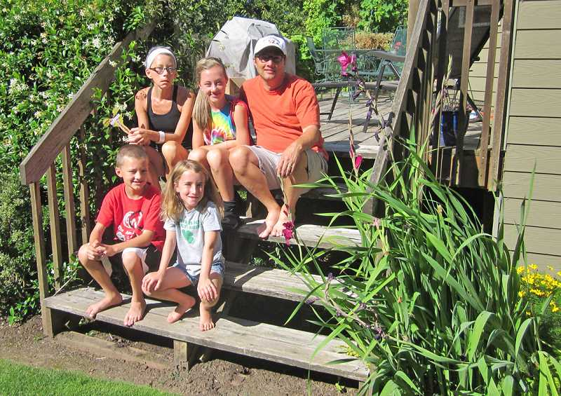 by: BARBARA SHERMAN -  BATTLING BACK - The Vranizan family, sitting on their back deck steps, includes (back row) Jennifer, Abby, who will turn 15 in September, and Tim, plus (front row) Henry, who will be 11 in September, and Lily, 8.