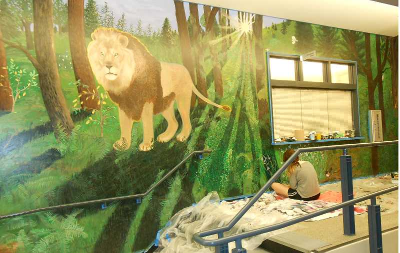 by: TIDINGS PHOTO: JORDY BYRD - Samantha Neverick details flora and fauna native to Oregon on the mural.