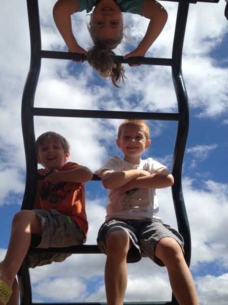 by: SUBMITTED PHOTO: SHAUNEEN DOYLE - Shauneen Doyle captured what she called a 'bittersweet moment' - the end of summertime freedom, at the Hallinan Elementary School playground this week. Pictured are, at top, Allie Doyle, who will be a first-grader at Hallinan in just a few days, and Cannen Cole and Lincoln Doyle, who attend Community Arts Preschool. Doyle said all three are eager and excited to get back to school.