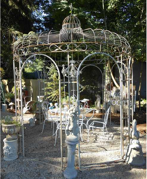 by: TIDINGS, REVIEW PHOTO: CLIFF NEWELL - The Iron Gate offers plenty of little things, but it also offers big things, like this rather amazing iron gazebo, suitable for moon gazing, meditating, etc.