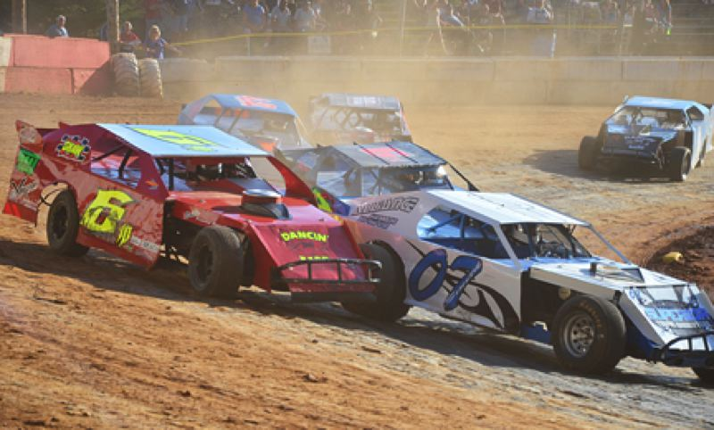 by: JOHN BREWINGTON - It's a little tight in the first turn for the Modified Division in a heat race on Saturday. The race had to be restarted after the  tangle. Dan Smith (07) would eventually win this race.