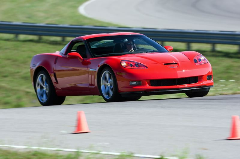 by: CHEVROLET MOTOR CO. - The 2013 Corvette Grand Sport excels on the track, but is surprsingly easy to drive in day-to-day traffic, too.