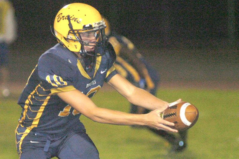 by: THE OUTLOOK: DAVID BALL - Barlow QB Alex Plusquellec reaches out to make a hand-off during Fridays game. Bruins coach Terry Summerfield tested three quarterbacks on the night.