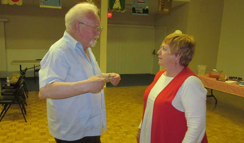 by: BARBARA SHERMAN - MEASURE WOULD MUZZLE OFFICIALS -- King City Mayor Ron Shay, a leading opponent of the public rail transportation measure, chats with Rep. Margaret Doherty (D-Tigard), who represents Dist. 35 in the Legislature, following a meeting of the King City Democrats.