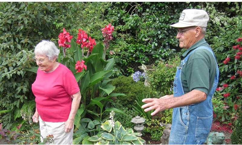 by: BARBARA SHERMAN - SAVORING THE SIGHTS, TASTES AND SMELLS -- Mel and Marie Faria spend a lot of time outside in the summer in their beautiful back yard.