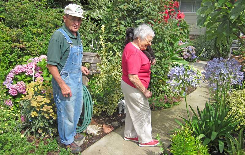 by: BARBARA SHERMAN - BOUNTY OF THE EARTH -- Mel and Marie Faria enjoy the fruits of their labor, eating fresh fruits and vegetables and cooking with produce from their garden every day; their dog Zoe enjoys tagging along.