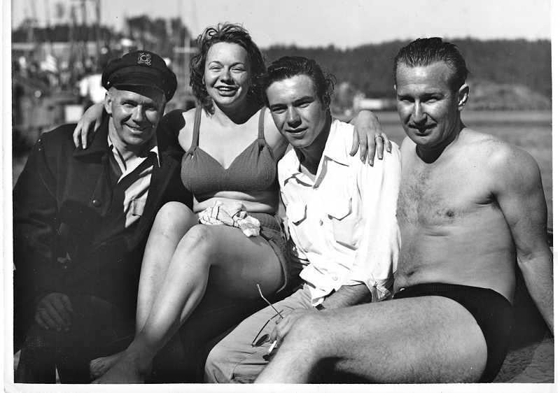 by: SUBMITTED PHOTO: WESTERN WATER SKI MUSEUM - Making up a happy quartet, from the left, are Wallace Worthington, his daughter Willa Worthington, Willa's boyfriend, and a local water ski enthusiast.