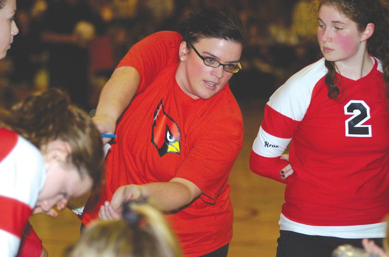 by: THE OUTLOOK: DAVID BALL - Corbett volleyball coach Angela Davis goes over some defensive pointers during a match last season. She led the Cardinals to a 29-1 record and a third-place finish at the 3A state tournament in 2011.