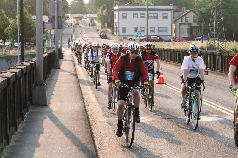 by: DAVID F. ASHTON - It's a horde of riders, heading across the Sellwood Bridge during the Portland Bridge Pedal.