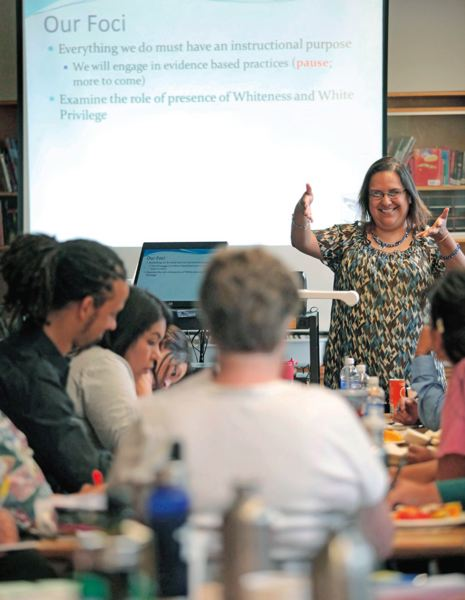 by: JONATHON HOUSE/TRIBUNE PHOTO - Harvey Scott School Principal Dr. Verenice Gutierrez leads a talk about race with her staff just before the school year starts. Racial equity is a top focus for the school and district.