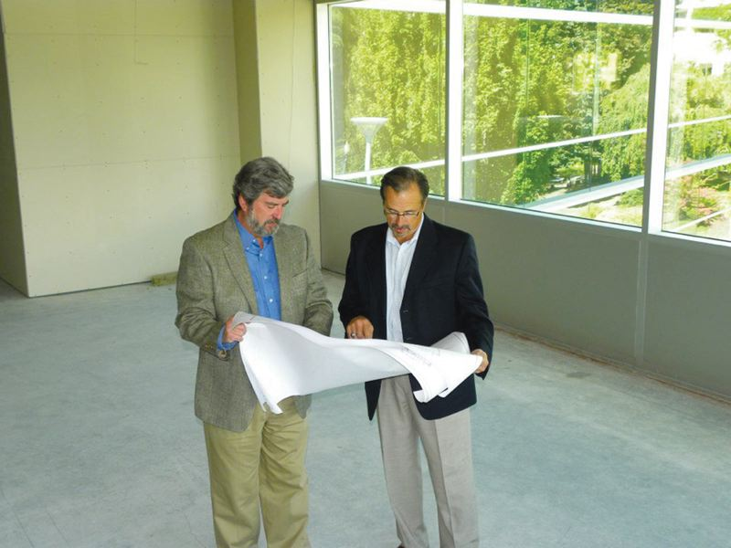 Washington County Museum Director Sam Shogren (left) and Hillsboro Mayor Jerry Willey looked over plans for the museum's new space in the Hillsboro Civic Center last week.