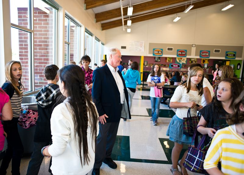 by: NEWS-TIMES PHOTO: CHASE ALLGOOD - Banks School District Superintendent Bob Huston greets students in the lunch room of Banks Junior High School, which will soon morph into a middle school, adding sixth graders to the mix.