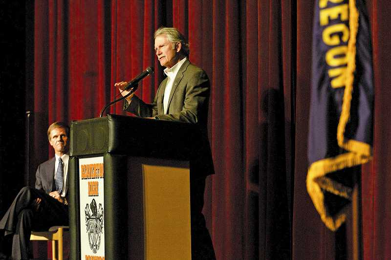 by: JAIME VALDEZ - Gov. John Kitzhaber explains his health care plan to a small crowd in the Beaverton High School Auditorium.