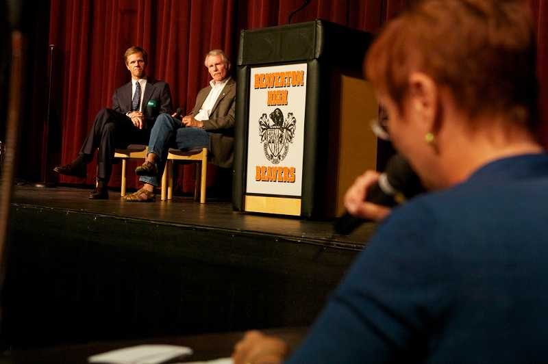 by: JAIME VALDEZ - State Sen. Mark Hass and Gov. John Kitzhaber listen as Alice Bartelt from the League of Women Voters poses a question from the audience during a health care discussion Tuesday night at Beaverton High School.