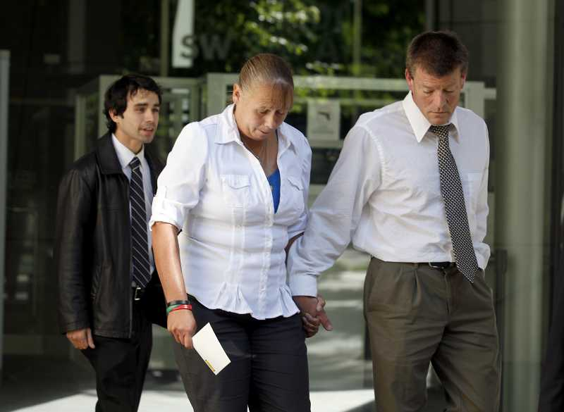 by: TIMES PHOTO: JONATHAN HOUSE - Hope and Brad Glenn talk with the media in front of Portlands federal courthouse Aug. 30 after a jury sided with their wrongful death lawsuit against Washington County sheriffs deputies in the 2006 killing of their son Lukus.