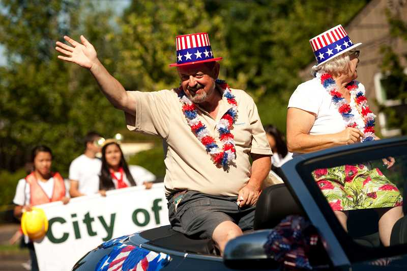 by: CHRISTOPHER ONSTOTT - Mayor Dennis Doyle and his wife Ann interact with citizens during last year's Beaverton Celebration Parade. The pageantry returns Saturday at 10 a.m.