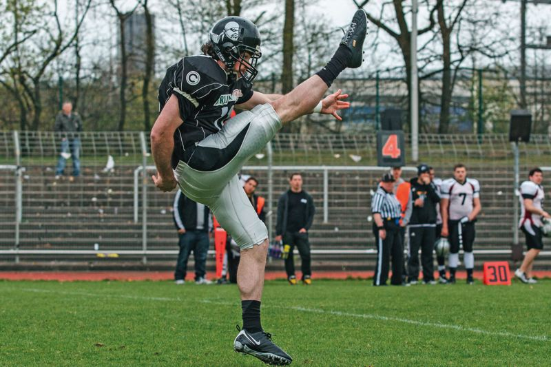 by: COURTESY OF MATT EVENSEN - Matt Evensen, a former PIL all-leaguer in football and soccer at Franklin High, is kicking and punting for the Berlin Rebels of the German Football League.