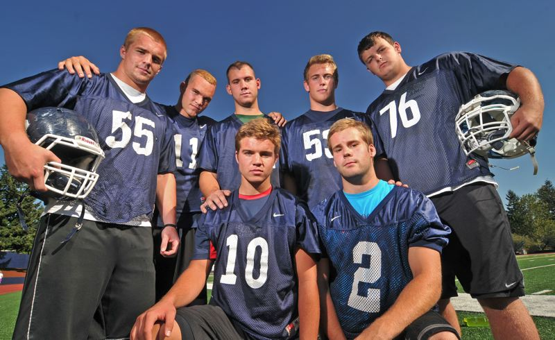 by: VERN UYETAKE - Clockwise from left, Austin Faunce, Jack Anderson, Mitch Lomax, Kyle Peterson, Noah Peterson, J.B. Holmes and Justen Ruppe take the reins for the Lakers this year as the team looks to repeat after capturing its first football state title.