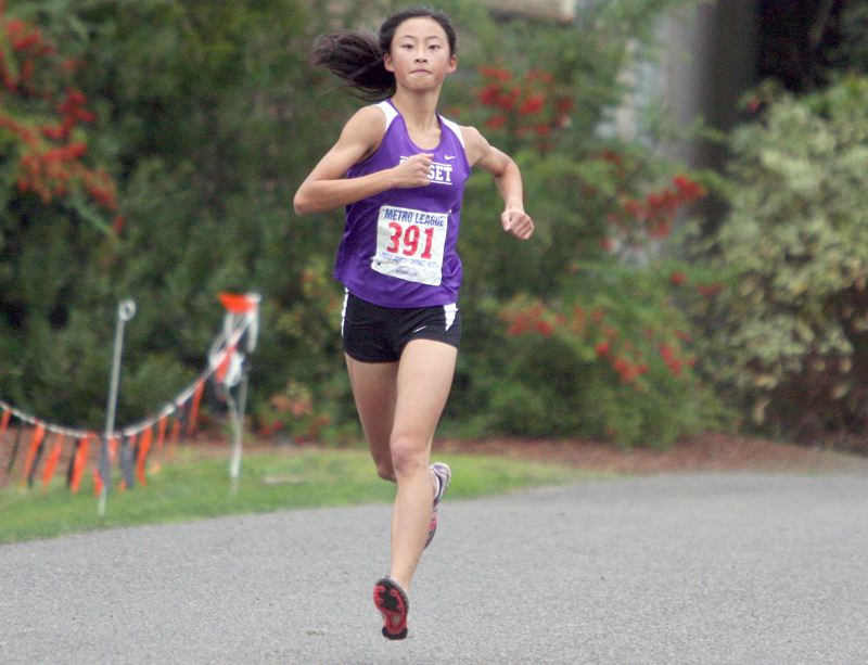 APOLLO LEADER - Sunset senior Karen Qu and her Apollo teammates are hoping to challenge the long dominance of Jesuit in Metro League girls cross country this year, but know that the Crusaders will be tough again.