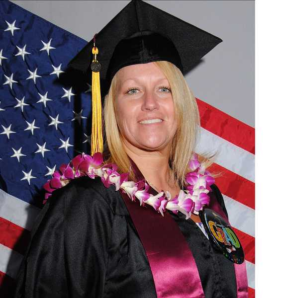 Deborah Grace recently graduated from the University of Phoenix Oregon campus with bachelor of science in business management. She's the first in her family to receive a college degree.