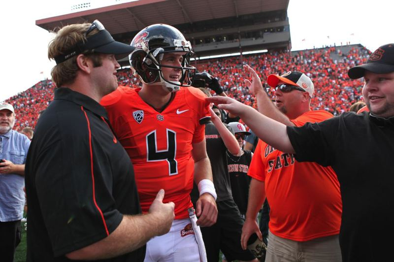 by: TRIBUNE PHOTO: JAIME VALDEZ - Oregon State quarterback Sean Mannion celebrates with fans at Reser Stadium after Saturday's 10-7 upset of 13th-ranked Wisconsin.