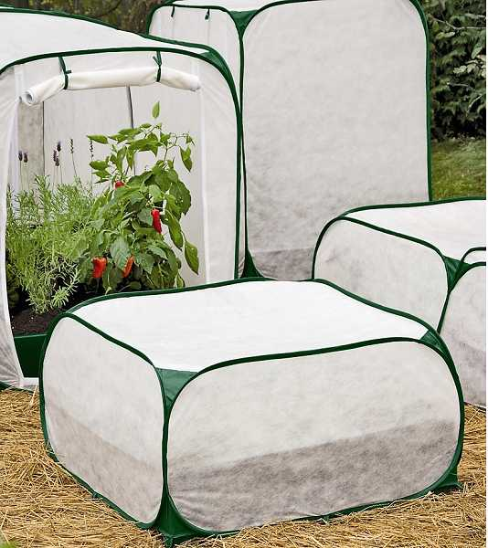 by: SUBMITTED PHOTO - The fabric traps heat around your plants, but allows air, light and water through.