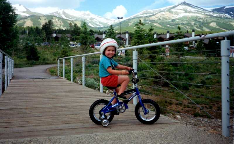 by: SUBMITTED PHOTO: MAGGIE EDWARDS - Jack Rising proved at an early age that juvenile diabetes was not going to stop him from being an athlete. He is shown here at age 2 1/2, just before the training wheels were taken off his bicycle.