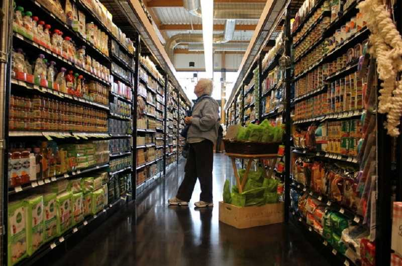 by: SUBMITTED PHOTO - A shopper wanders the aisles at Zupanan's in Lake Grove.
