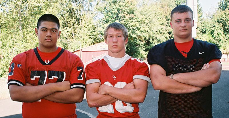 by: JOHN DENNY - Oregon City team captains (from left) Austin Phanouvong, Mitchell Thompson and Michael McCoy believe the Pioneers will hold their own in the Three Rivers League this fall.