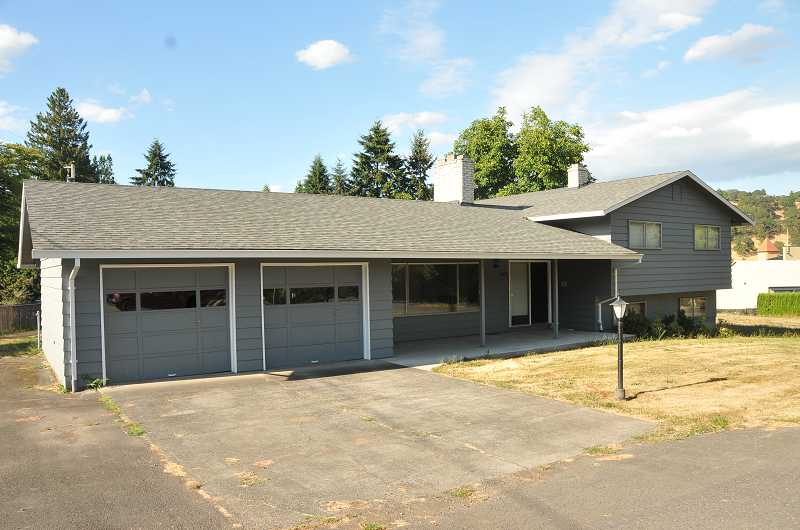 by: VERN UYETAKE - Homes at 1800 Eighth Ave., 1819 13th St. and 1849 13th St. will be demolished sometime this month to make room for West Linn's new police station.