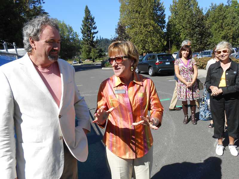 by: CLIFF NEWELL - Judi Johansen, president of Marylhurst University, had an enthusiastic speech at the groundbreaking celebration for the Bellluschi House. At left is Michael Lammers.