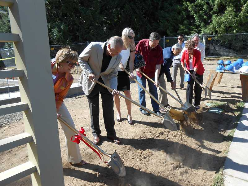 by: CLIFF NEWELL - Marylhurst's Executive Vice President Michael Lammers and President Judith A. Johansen join Anthony Belluschi, Sara Bailey of the Kinsman Foundation, Tim Mather, Peter Belluschi and Sue Griffith at the ceremonial groundbreaking of the Belluschi Pavilion at Marylhurst University. Anthony and Peter are the sons of Pietro Belluschi, the world-renowned architect who designed the home.