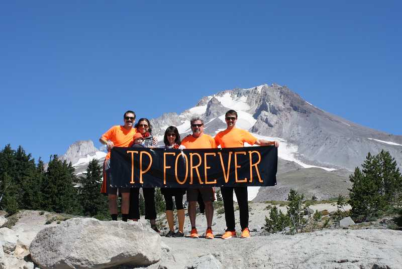 by: SUBMITTED - Tony Platt's family unfurls the banner of TP Forever during the Hood to Coast event held in August. They competed as a team and kept Tonys name on the roster.