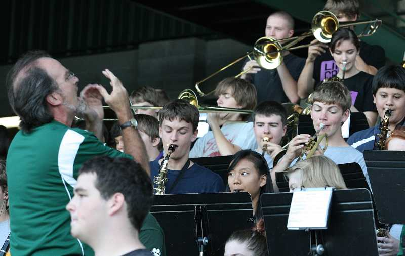 by: J. BRIAN MONIHAN - Members of the West Linn High School marching band entertain the crowds during the game.