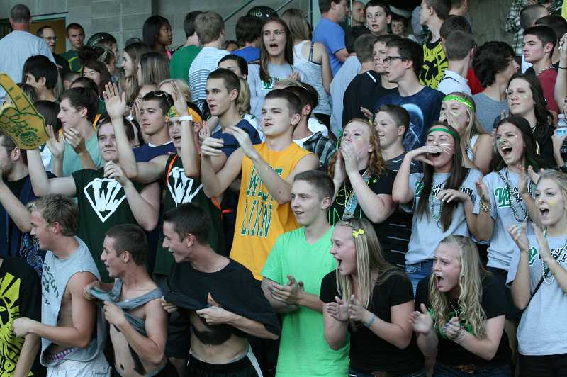 by: J. BRIAN MONIHAN - Students cheer their team on as the Lions work back from a significant deficit.