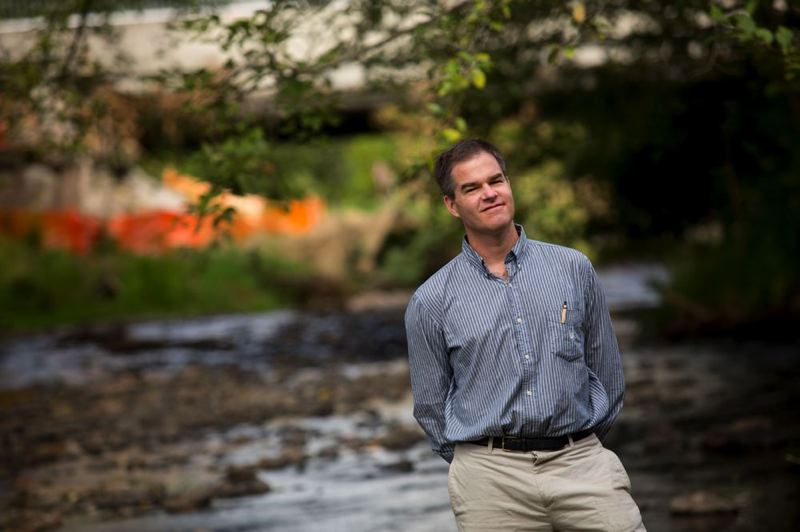 by: PAMPLIN MEDIA GROUP: CHRISTOPHER ONSTOTT - Matt Clark, executive director of the Johnson Creek Watershed Council, has plans to rehabilitate Johnson Creek as part of the new MAX station under construction near the Tacoma Street overpass at McLoughlin Boulevard.