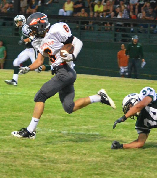 by: JOHN BREWINGTON - Hard to catch. Scappoose's Paul Revis proved difficult to stop for Estacada Friday. Revis had three touchdowns in a 26-20 win.
