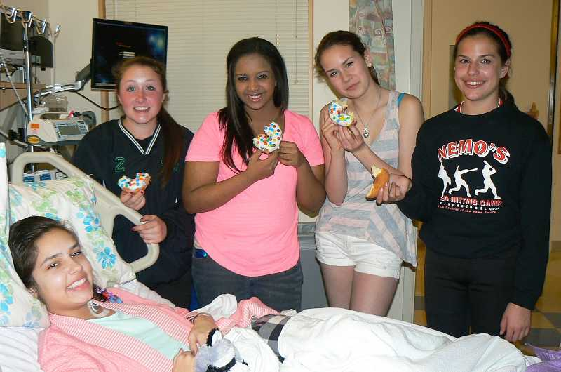 by: SUBMITTED - Stella Preston, Emma Dozier, Jordan Harden and Rowan Marshall visit Bailey in the hospital. Bailey was at Doernbecher for a month as she was treated for hemolytic-uremic syndrome, brought on by an E. Coli infection.