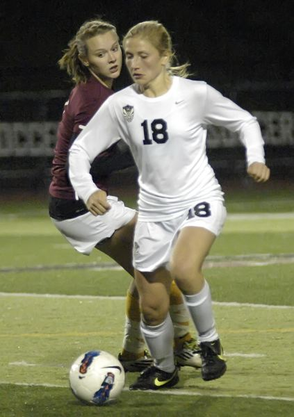 by: DAN BROOD - ONE OF MANY -- Lauren Helmreich is one of 15 returnees from last year's state champion Tualatin High School girls soccer team.