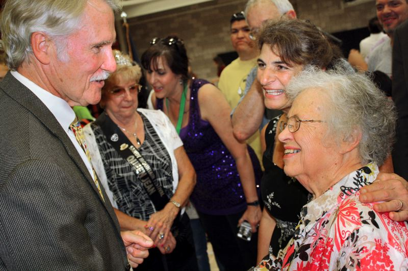 by: LISA K. ANDERSON - Nancy Enabnit, executive director of the Sandy Senior center, introduces Gov. John Kitzhaber to a 1936 Sandy High graduate, Grace Wewer RIch.