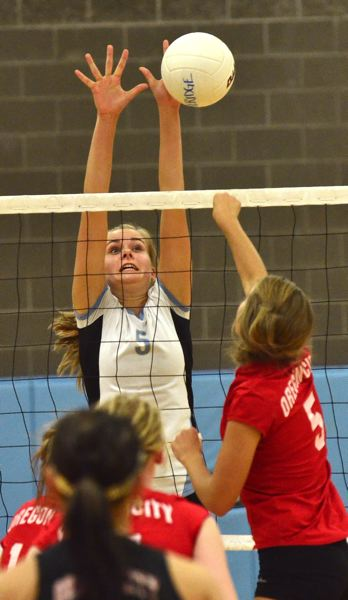 by: VERN UYETAKE - Madison Marshall is one of two talented middle blockers returning for Lakeridge's volleyball season this year along with Saskia McNairy.